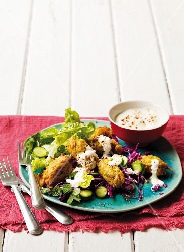 Carrot and cumin falafel with yoghurt and salad