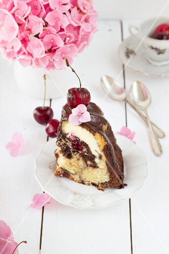 A slice of Donauwelle (German marble cake) Bundt cake with a cheesecake filling