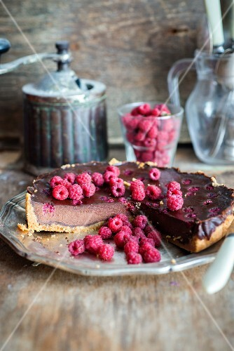 Chocolate tart with a baked chocolate custard filling and raspberries