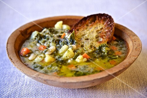 Tuscan vegetable soup with olive oil and toasted bread