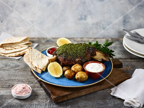 Slow-roast shoulder of lamb with a herb crust (Greece)