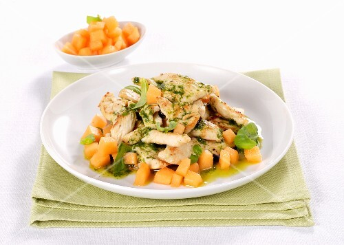 Herb-coated chicken with melon