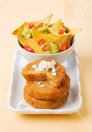 Fried green tomatoes with guacamole and tortilla chips