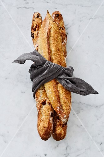 Three french baguettes tied up