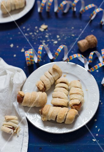 Sausages wrapped in puff pastry for New Year's Eve