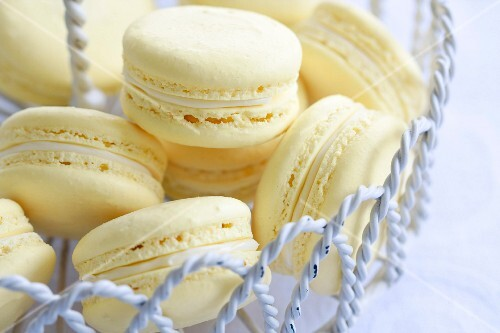 Lemon flavored macarons in a wire dessert stand