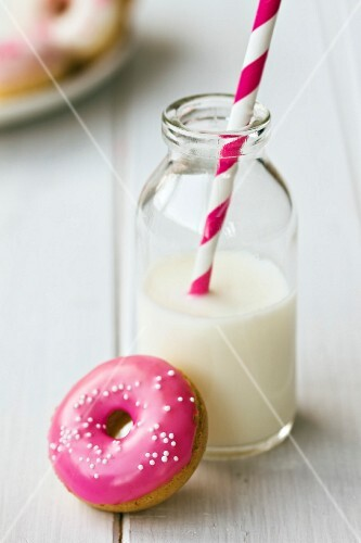 Doughnut served with a mini bottle of milk