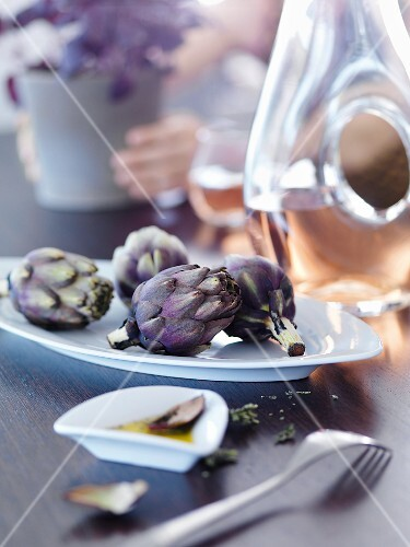 Artichokes with olive oil on a dining table