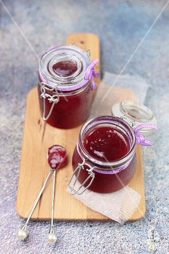 Red fruit jam in two glass jars