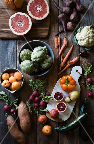 Assorted vegetables and fruit on a rustic wooden table