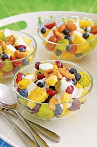 Fruit salad with pineapple, grapes and blueberries