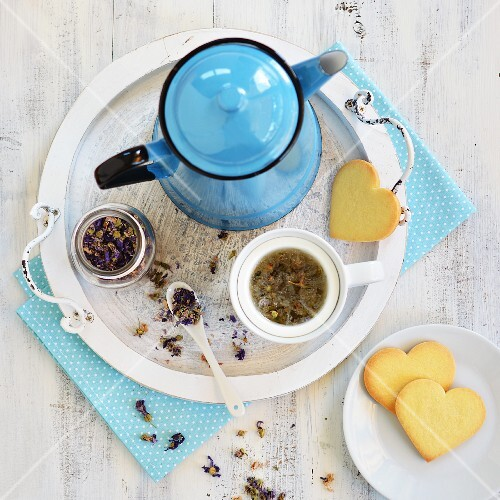 Mallow tea in a teapot with biscuits
