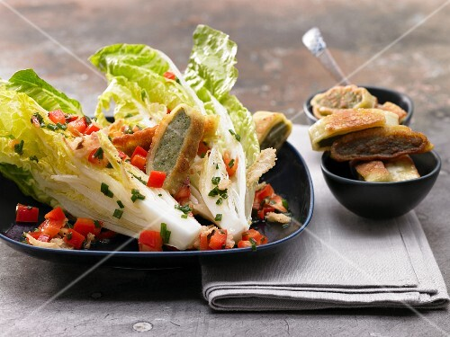 Pan-fried Maultaschen (Swabian ravioli) with cos lettuce and red pepper