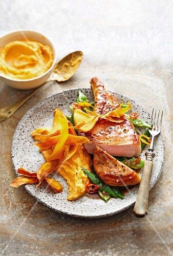 Sweet potato purée with pork chops and chilli beans