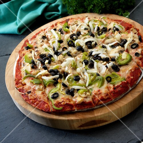 Pizza with green pepper, olives, mushrooms and onions