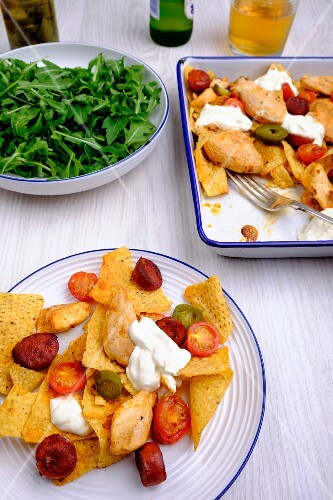 One-pot nachos with chicken, chorizo, jalapeno peppers and cherry tomatoes