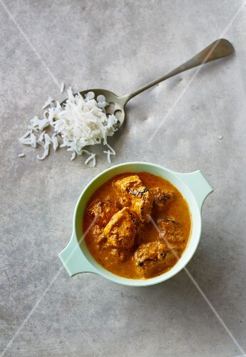 Chicken and coconut curry with a spoonful of rice