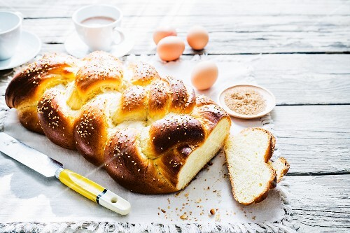 Challah (a Jewish sweet bread plait) with ingredients and coffee