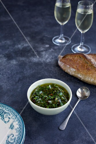 Italian salsa verde served with bread and white wine