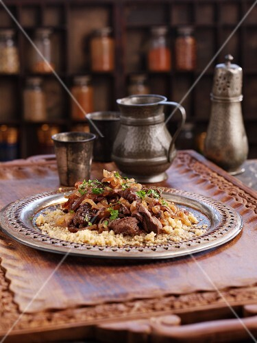 Beef tagine on a bed of couscous (North Africa)