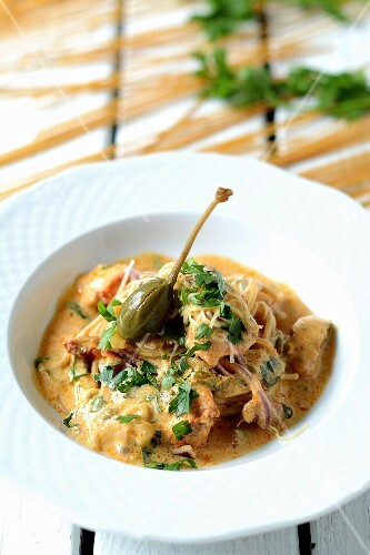 Chicken curry with noodles and giant capers