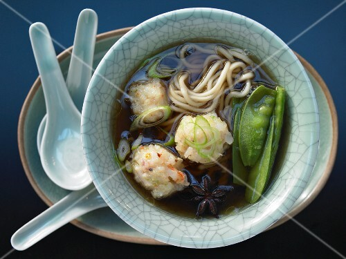 Shrimp ball soup with snow peas and mie noodles