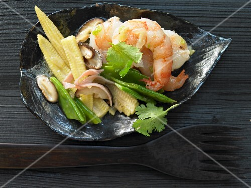 Prawns in an egg white coating with baby corn cobs, snow peas and shiitake mushrooms