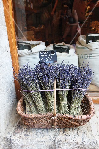 Lavender in a basket in front of a shop window