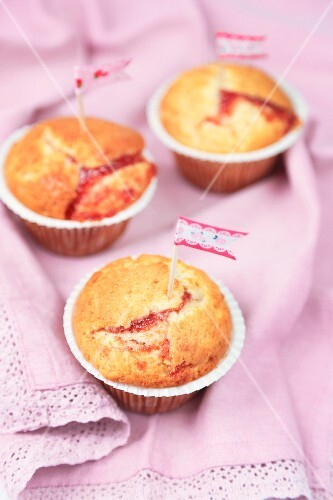Jam-filled muffins decorated with little flags