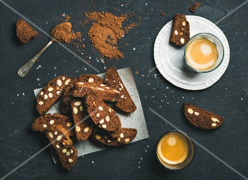 Dark chocolate and sea salt Biscotti with almonds and two glasses of coffee espresso