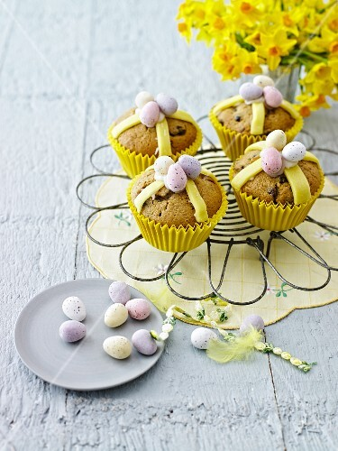 Hot cross muffin topped with chocolate mini eggs