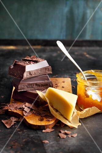 Ingredients for layered cake: chocolate, apricot jam and marzipan