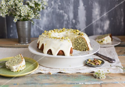 Lemon and poppy cake with pistachios, sliced