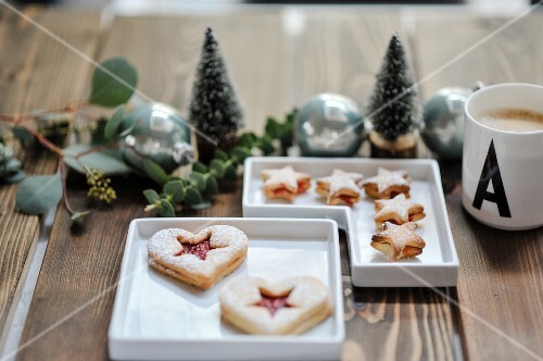 Two pastries in small bowls and a Christmas table decoration