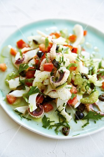 Octopus salad with celery, tomato and black olives
