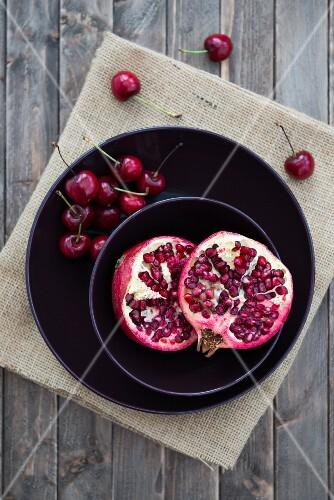 Pomegranate and cherries in a bowl