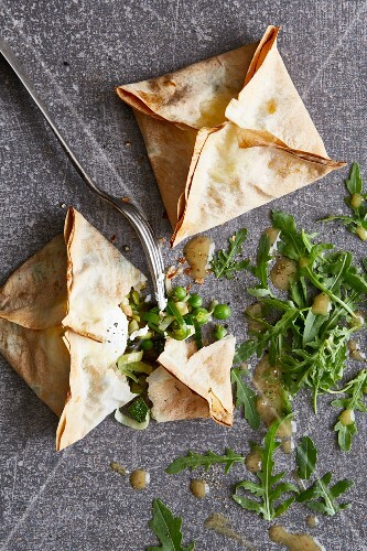Filo pastry parcels filled with green vegetables and goat's cheese