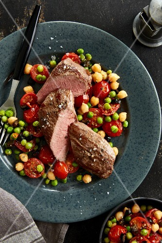 Lamb fillet with fried tomatoes with peas and chickpeas
