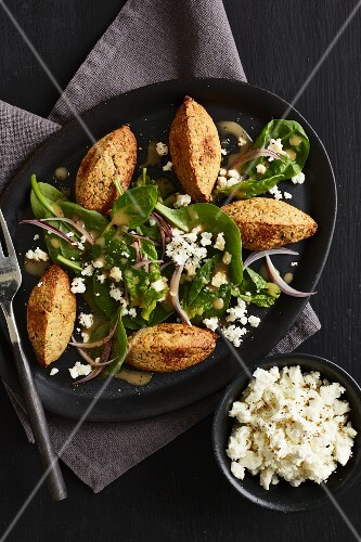 Spinach salad with cauliflower falafel and feta