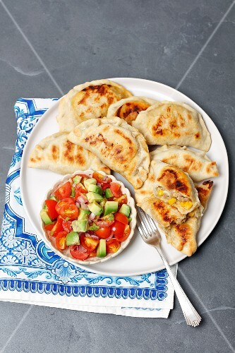 Baked empanadas with beef and corn, avocado and tomato salsa