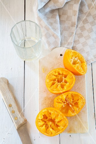 Pressed oranges on a cutting board