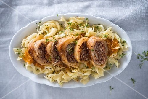 Cabbage rolls stuffed with beef on pasta with red vegetable sauce (vegan)