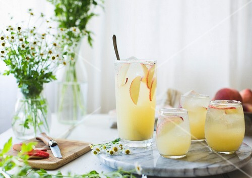 White Nectarine Prosecco Sangr¡a with Ginger and Elderflower in a glass