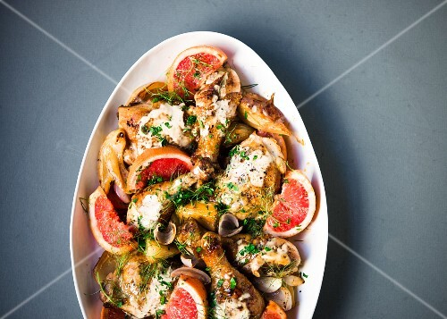 Braised chicken pieces with pink grapefruit and fennel