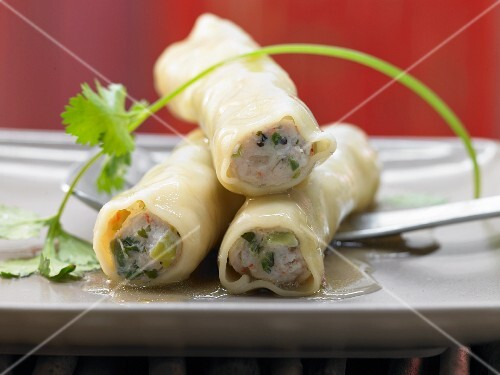 Asian cannelloni with salmon and prawn filling steamed on lemongrass and lime