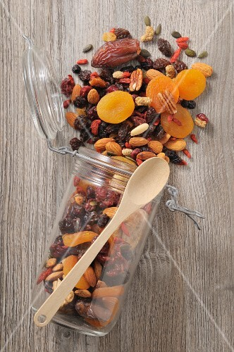 Dried fruit and nuts in storage jar