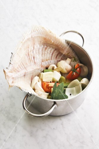Ingredients for homemade fish stock in a pan