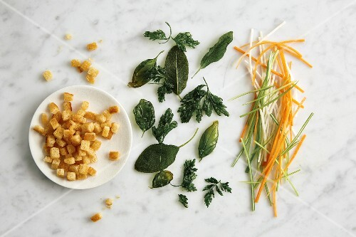 Toppings for soups: croutons, fried herbs and julienne-cut vegetables