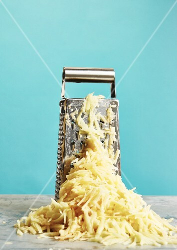 A grater with grated potato