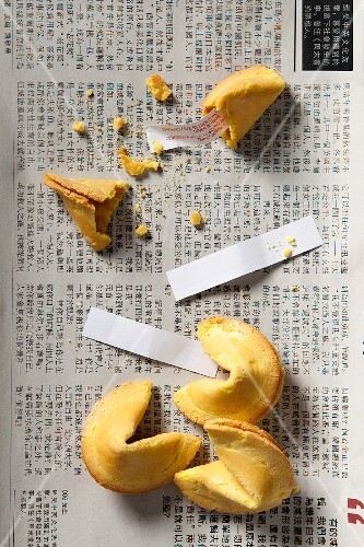 Fortune cookies, three whole and one smashed open